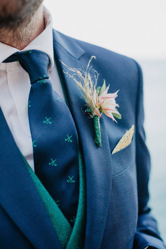 green and blue grooms suit