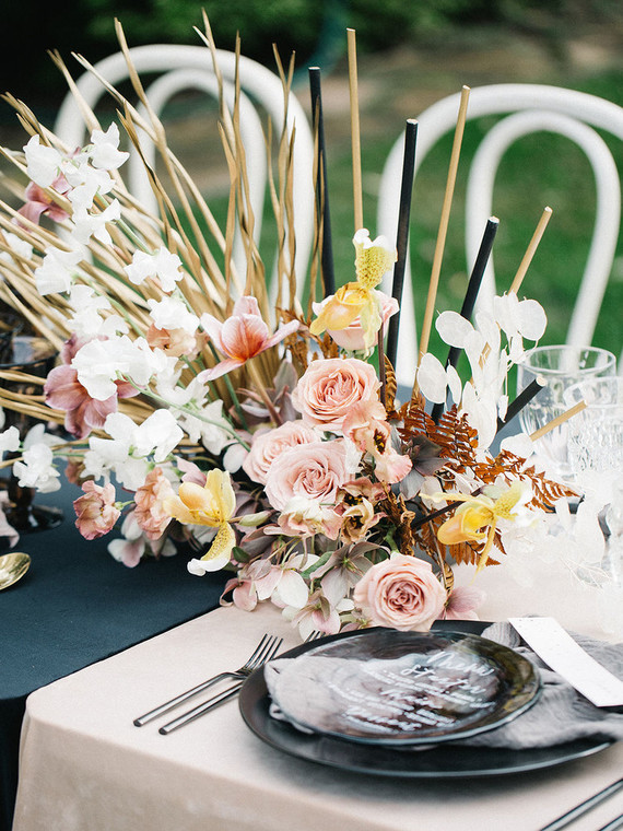 wedding centerpiece with gold accents