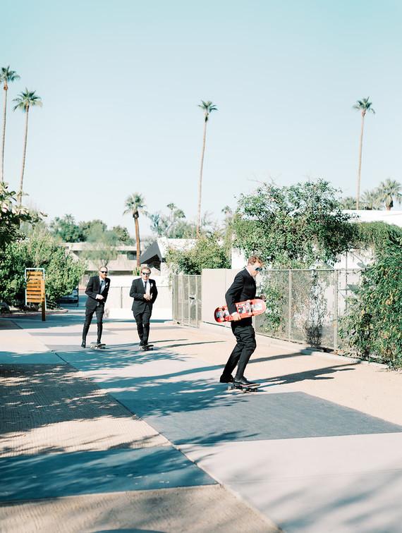 Groomsmen on skateboards