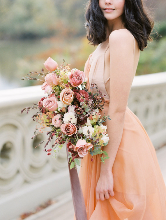 Fall Central Park bridal inspiration with a rust-toned Leanne Marshall dress