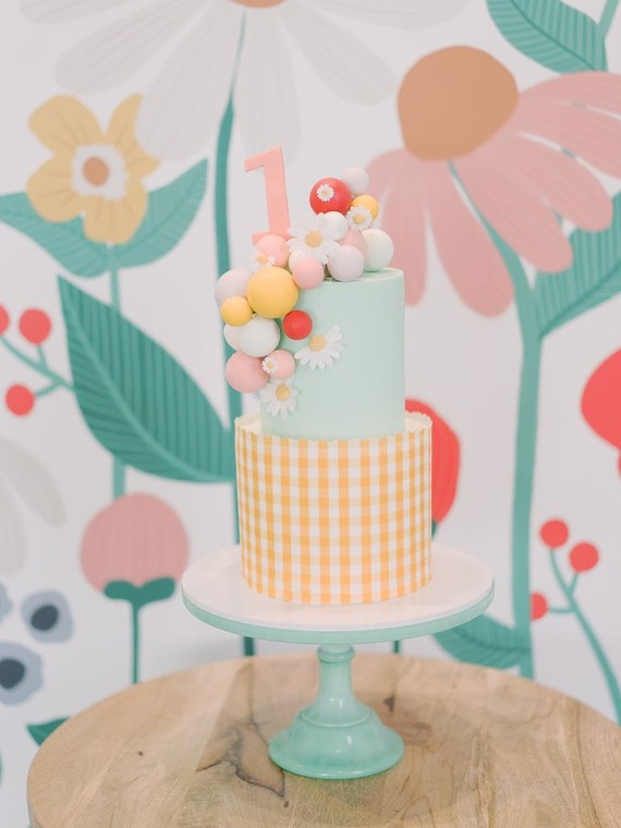 Whimsical first birthday cake