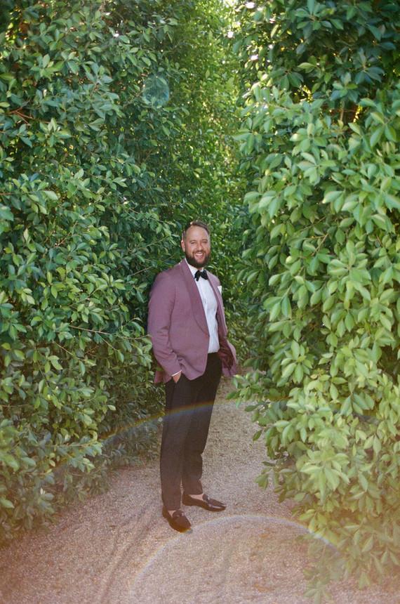 groom in pink suit jacket