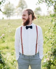 groom with suspenders