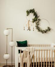 Gender neutral gold and emerald boho nursery
