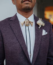 purple groom's suit