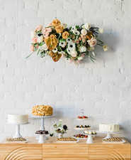 hanging florals above dessert table
